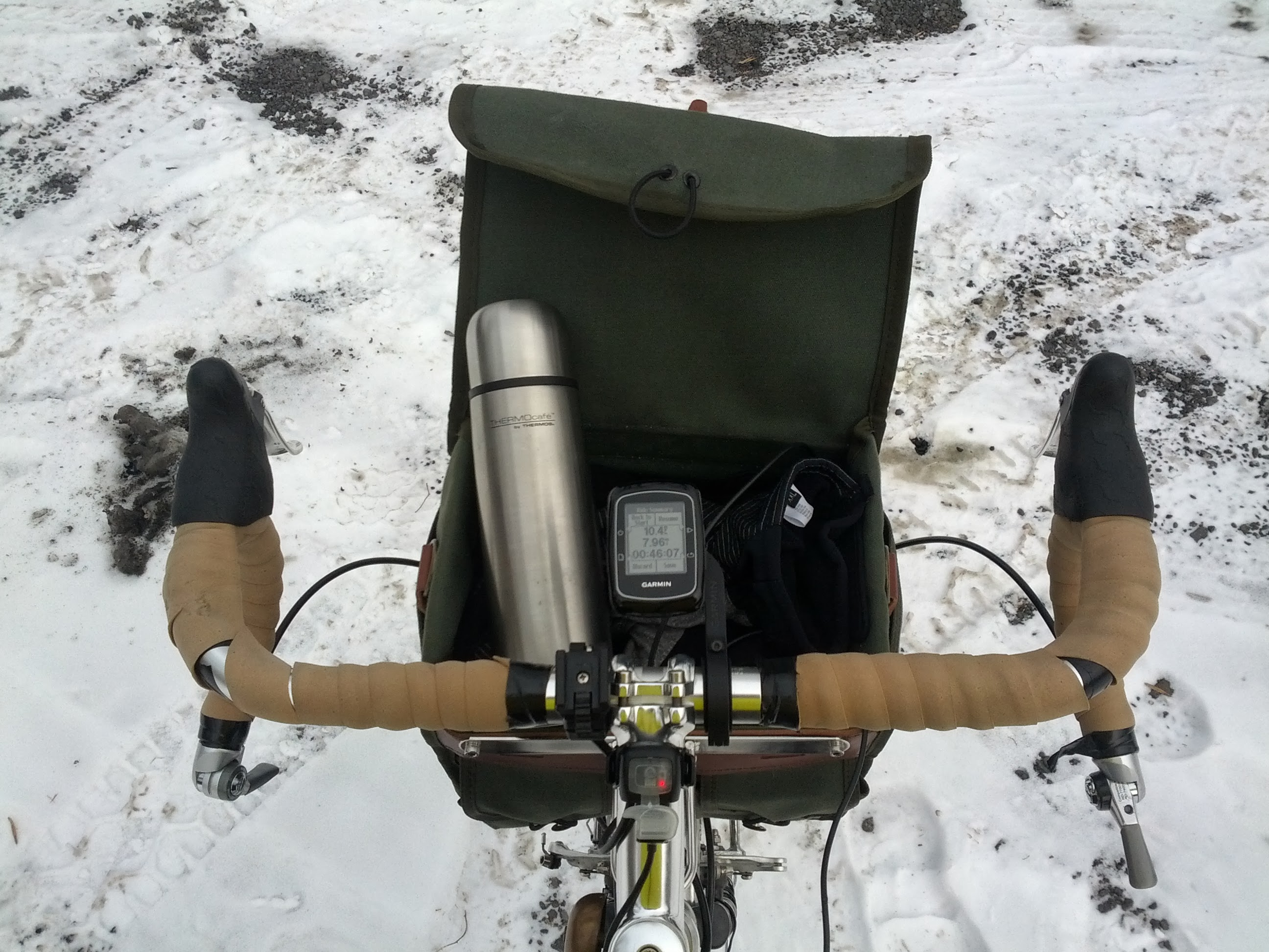 The cockpit of the Cross-Check.  Thermos of hot coffee in the handlebar bag.